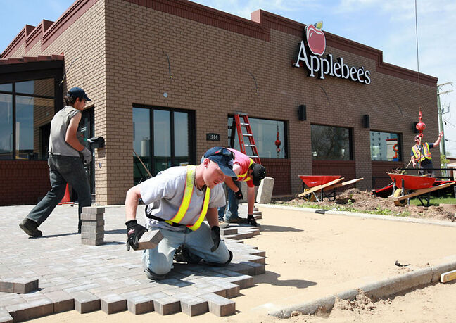 Crews work on the makeover at Applebee's restaurant on 18th Street on Wednesday afternoon.