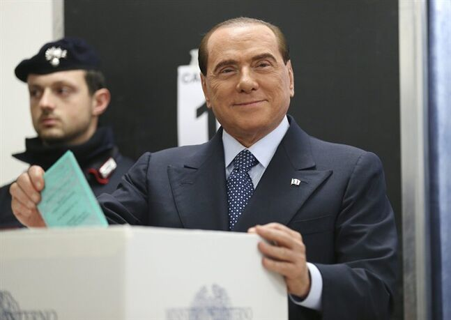 Former Premier Silvio Berlusconi casts his ballot in Milan, Italy, Sunday, Feb. 24, 2013. THE CANADIAN PRESS/AP, Antonio Calanni
