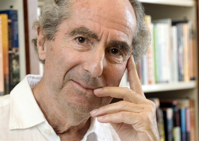 "FILE - In this Sept. 8, 2008 file photo, author Philip Roth poses for a photo in the offices of his publisher Houghton Mifflin, in New York. Roth apparently still isn't done with his retirement, especially when tempted by the chance to chat with Stephen Colbert. Comedy Central spokesman Steve Albani told The Associated Press on Wednesday, May 21, 2014, the celebrated novelist has agreed to an ""extended interview"" in July for the cOlbert Book Club. (AP Photo/Richard Drew, file)"