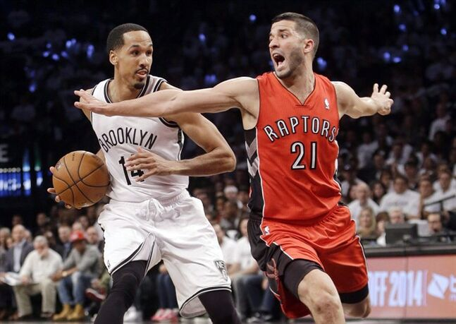 Toronto Raptors' Greivis Vasquez (21) defends Brooklyn Nets' Shaun Livingston (14) during the second half of Game 6 of the opening-round NBA basketball playoff series Friday, May 2, 2014, in New York. Vasquez says he'd love to play out his NBA career in Toronto, and he's even signed on as an ambassador for next summer's Pan American Games. THE CANADIAN PRESS/ AP/Frank Franklin II