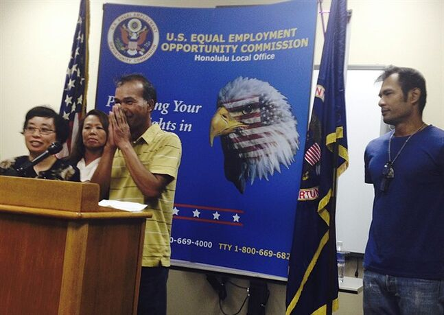 Khamjuan Namwichai, center, greets reporters at a news conference in Honolulu on Tuesday, June 3, 2013. Namwichai spoke in Thai to describe unsanitary conditions working at Hawaii farms, as Mimi Cheou, an Equal Employment Opportunity Commission (EEOC) investigator, left, translates. Also pictured are Anna Park, EEOC Los Angeles regional attorney, second from left, and Thai worker Likhit Yoo-on. The U.S. EEOC announced details of settlements totaling $2.4 million by four farms the agency sued for discriminating against hundreds of Thai workers. (AP Photo/Jennifer Sinco Kelleher)