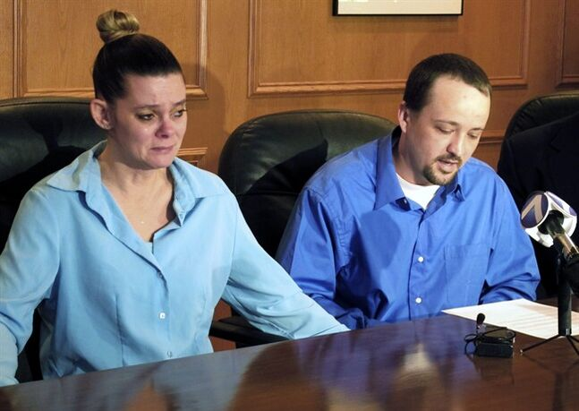 "FILE - In this Jan. 17, 2014, file photo, Missie McGuire, left, listens to her husband, Dennis McGuire, at a news conference where they announced their planned lawsuit against the state over the unusually slow execution of his father, also named Dennis McGuire, in Dayton, Ohio. The state said Tuesday, April 29, 2014, that it is boosting the amount of the two-drug combo of a sedative and painkiller ""to allay any remaining concerns"" after the last execution, when Dennis McGuire made repeated snorting-like gasps as he died. (AP Photo/Kantele Franko, File)"