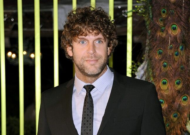 FILE - In this Nov. 8, 2011 file photo, country singer Billy Currington arrives at the 59th Annual BMI Country Awards in Nashville. Currington is being sued by a Georgia tour boat captain who pressed criminal charges against him last year. He was sentenced to five years' probation in September after pleading no contest to a charge of abuse of an elderly person. Prosecutors say he chased and threatened 70-year-old Charles Harvey Ferrelle after his boat passed Currington's home on Tybee Island. (AP Photo/Evan Agostini. File)
