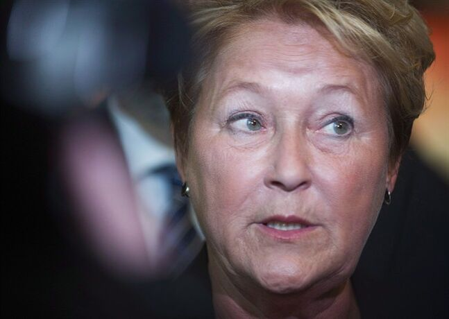 Quebec Premier Pauline Marois speaks to reporters following a funding announcement at a theatre in Montreal, Tuesday, January 14, 2014. THE CANADIAN PRESS/Graham Hughes