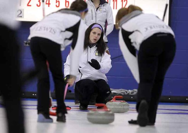 Skip Jennifer Curle calls off her sweepers in an afternoon draw in the provincial junior curling championships.