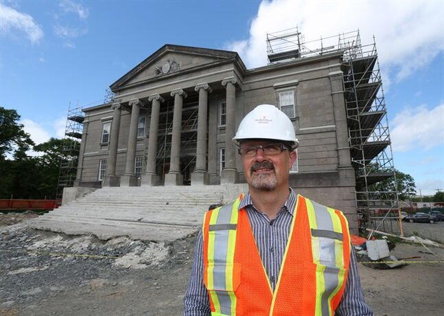 Jerry Dick, Director of Heritage, Culture and Recreation, stands outside the historic Colonial Building in St. John's, NL on July 17, 2014. The building, which opened in 1850 as home to the first Newfoundland Legislature, is undergoing a restoration project involving both �inside and outside the building. �THE CANADIAN PRESS/Paul Daly