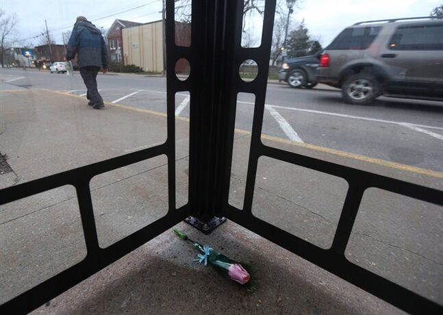 A single rose in memory of Harley Lawrence is shown inside a bus shelter along Commercial Street in Berwick, N.S. on April 25, 2014. THE CANADIAN PRESS/Mike Dembeck.