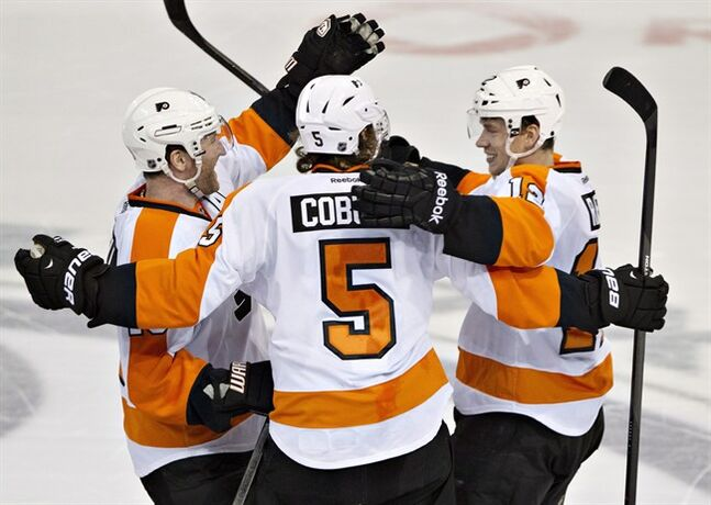 Philadelphia Flyers' Scott Hartnell (19), Braydon Coburn (5) and Michael Raffl (12) celebrate the win over the Edmonton Oilers during in the shootout in NHL hockey action in Edmonton, Alta., on Saturday December 28, 2013. THE CANADIAN PRESS/Jason Franson