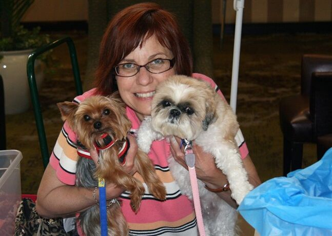 This 2008 photo provided by Debra Beilstein shows Debra J. Bellstein with her dogs Mica a 13-year-old Yorkie, left, and a Shih Tzu named Tutti, 11, during an event at the Yorkshire Terrier Club of Los Angeles.