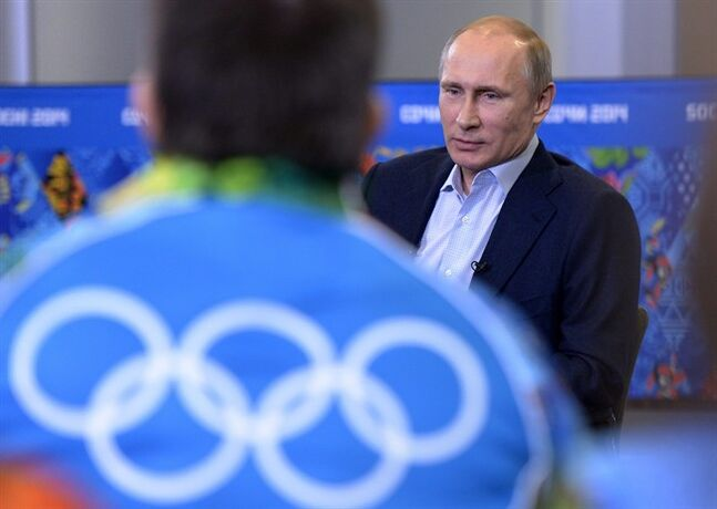 Russian President Vladimir Putin speaks at his meeting with Olympic volunteers in the Black Sea resort of Sochi, Russia, Friday, Jan. 17, 2014. Putin says gays should feel welcome at the upcoming Winter Olympic Games in Sochi, but they must