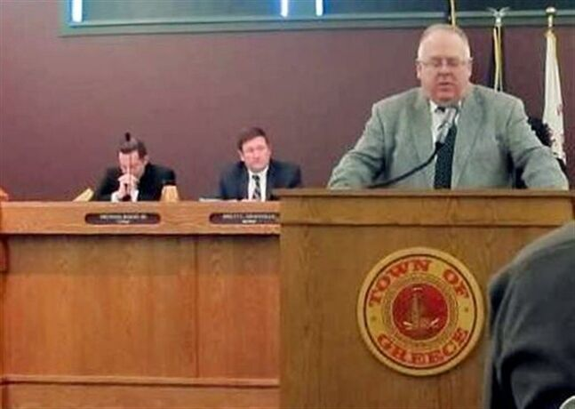 FILE - In this March 18, 2014 file photo, Pastor Mike Metzger, right, of First Bible Baptist Church, leads a moment of prayer at the start of the Greece Town Board meeting in Greece, N.Y. The Supreme Court said Monday that prayers that open town council meetings do not violate the Constitution even if they routinely stress Christianity. (AP Photo/Carolyn Thompson)