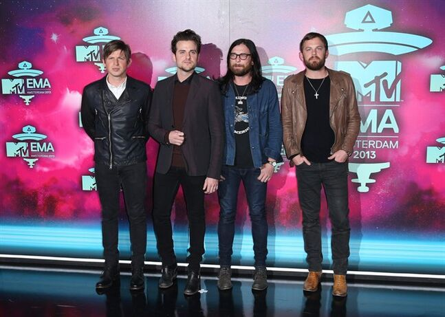 "FILE - In this Nov. 10, 2013 file photo, from left, Matthew Followill, Jared Followill, Nathan Followill and Caleb Followill of the band Kings of Leon pose for photographers upon arrival at the 2013 MTV Europe Music Awards, in Amsterdam, Netherlands. The city of brotherly love will mark a brotherly affair for Kings of Leon: The family band will play its first show Sunday, Aug. 31, 2014, in Philadelphia since drummer Nathan Followill injured his ribs. The group will headline the second night of the ""Budweiser Made In America"" festival on the Benjamin Franklin Parkway over Labor Day Weekend. (Photo by Joel Ryan/Invision/AP, file)"