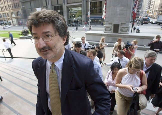 Joe Groia, lawyer for John Felderhof, walks back into court in Toronto on July 31, 2007. A prominent securities lawyer and the society that regulates the legal profession in Ontario are bound for court in the latest round of an epic battle started in the aftermath of the billion-dollar Bre-X mining fiasco in the late 1990s. Closely watched by the legal profession, the contest pits Joe Groia, who successfully defended the only person charged in the history-making securities scandal, against the Law Society of Upper Canada. THE CANADIAN PRESS/Frank Gunn