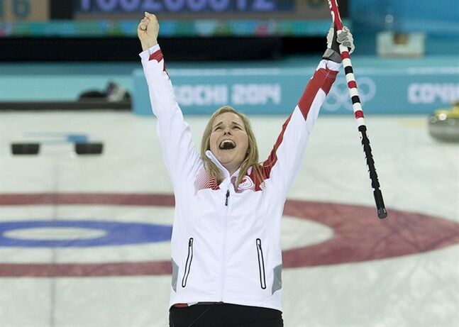 Canada skip Jennifer Jones jumps for joy as she wins the gold medal in the Olympic final curling against Sweden at the Sochi Winter Olympics Thursday February 20, 2014 in Sochi, Russia. THE CANADIAN PRESS/Adrian Wyld