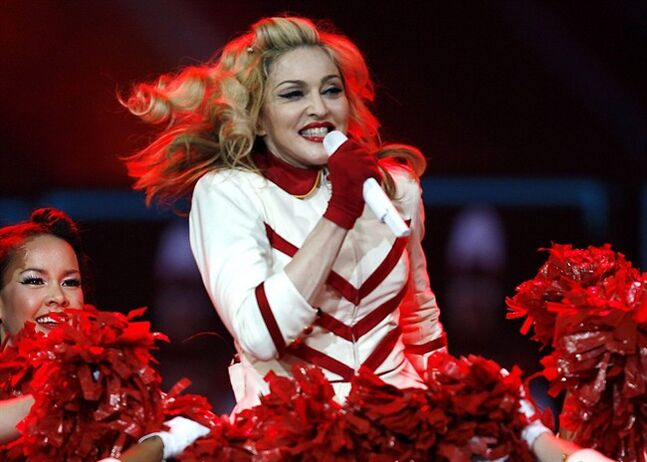 FILE - In this Nov. 8, 2012, file photo, Madonna performs at the Joe Louis Arena in Detroit. Madonna, who was