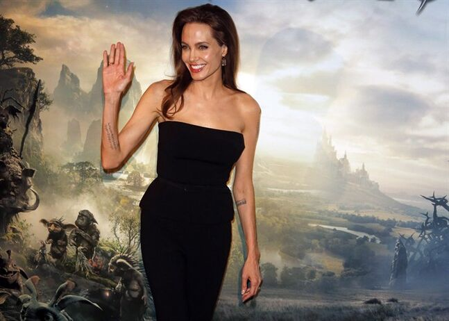 Actress Angelina Jolie waves during a photocall for the film