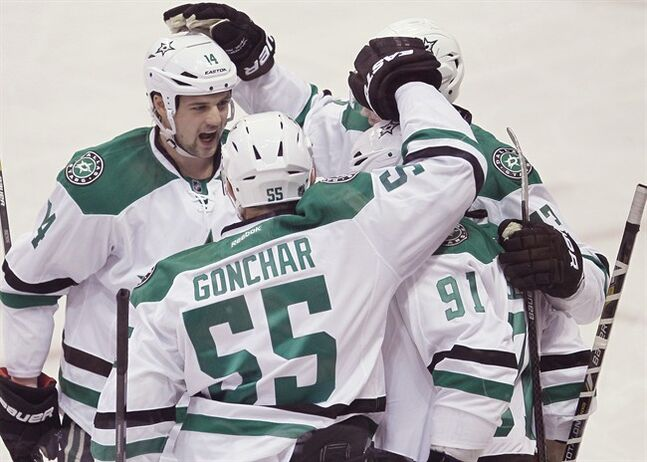 Dallas Stars' Jamie Benn (14), Sergei Gonchar (55), Valeri Nichushkin (43) and Tyler Seguin (91) celebrate Seguin's goal against the Winnipeg Jets during first period NHL action in Winnipeg on Saturday, December 14, 2013. THE CANADIAN PRESS/John Woods