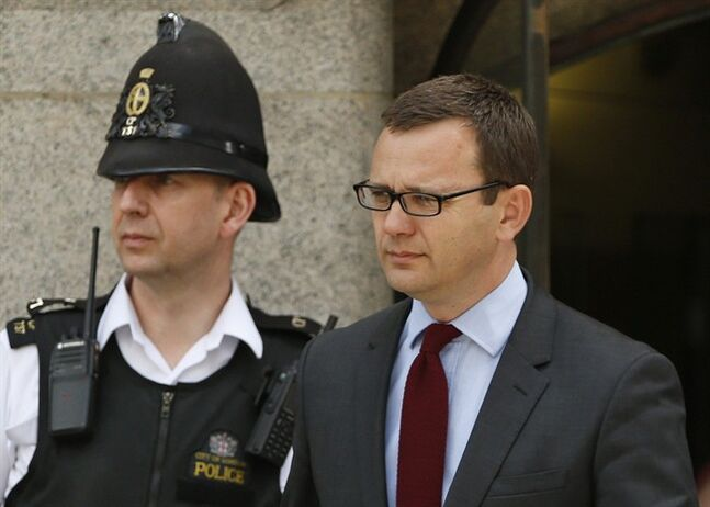 Andy Coulson, former News of the World editor and the former spin doctor of British Prime Minister David Cameron, leaves the Central Criminal Court in London, Wednesday, June 25, 2014. Coulson was convicted of phone hacking Tuesday, but fellow editor Rebekah Brooks was acquitted after a monthslong trial centering on illegal activity at the heart of Rupert Murdoch's newspaper empire. A judge on Wednesday dismissed the jury at Britain's phone-hacking trial after it failed to reach a verdict on two final counts, having convicted him of hacking a day earlier. Judge John Saunders ended the trial after jurors said they could not agree whether Coulson and ex-royal editor Clive Goodman were guilty of paying police officers for royal phone directories. Prosecutors said they would announce next week whether they would seek a retrial. (AP Photo/Lefteris Pitarakis)