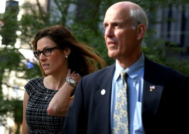 FILE - In this July 22, 2014, file photo, Taya Kyle, left, widow of Navy Seal and author Chris Kyle, arrives at court in St. Paul, Minn. Jurors in former Minnesota Gov. Jesse Ventura's defamation lawsuit against