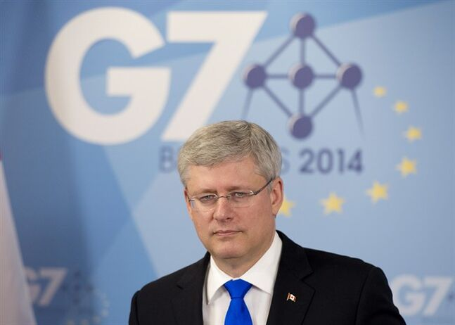 Canadian Prime Minister Stephen Harper speaks with the media during a news conference following the G7 meetings Thursday June 5, 2014 in Brussels, Belgium. THE CANADIAN PRESS/Adrian Wyld