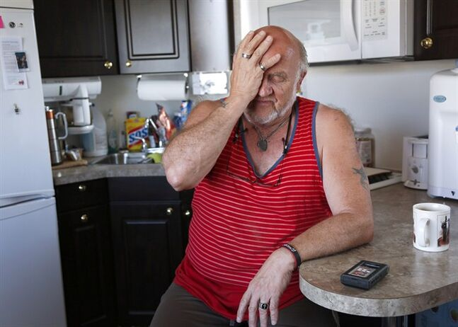 Fred Plotnikoff gestures in his trailer in High River, Alta., June 2, 2014.THE CANADIAN PRESS/Jeff McIntosh