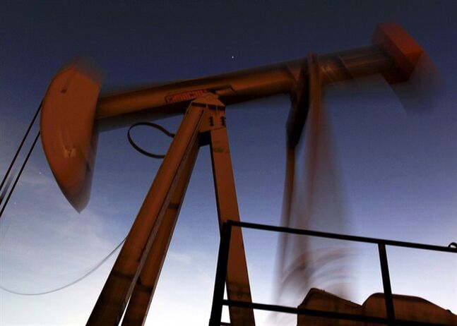 An oil pump works in the desert oil fields of Sakhir, Bahrain, Aug. 22, 2012. THE CANADIAN PRESS/AP, Hasan Jamali