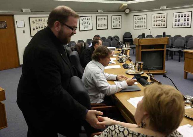 Renaissance Brandon chair Shaun Cameron greets people attending a meeting in council chambers at Brandon City Hall on Tuesday evening. Officials said improving communication between the downtown development corporation and the city was among the issues that were discussed.