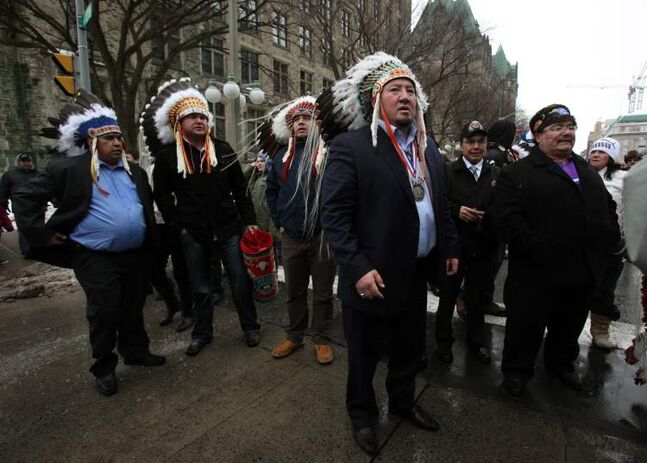 Grand Chief Derek Nepinak (front) of the Assembly of Manitoba Chiefs meets up with aboriginal protestors as they march from Victoria Island to Parliament Hill in Ottawa on Friday, January 11, 2013.