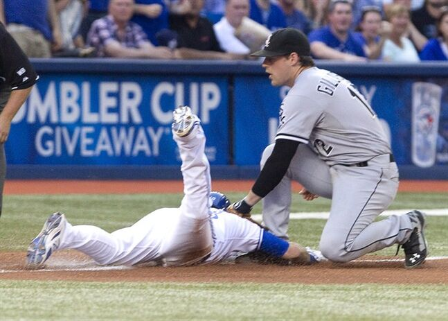 Toronto Blue Jays Steve Tolleson is out at third base caught leaning off third by Chicago White Sox third baseman Conor Gillaspie during second inning AL baseball game action in Toronto Friday June 27, 2014. THE CANADIAN PRESS/Fred Thornhill