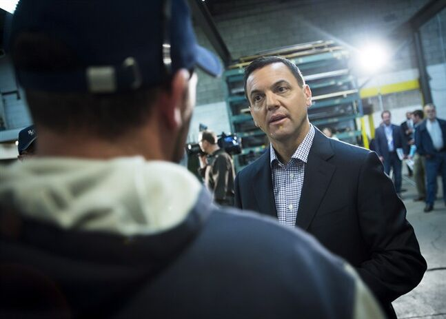Ontario PC Leader Tim Hudak greets employees at Ranfar Steel Ltd. while campaigning in Courtice, Ont. on Saturday, May 10, 2014. THE CANADIAN PRESS/Darren Calabrese
