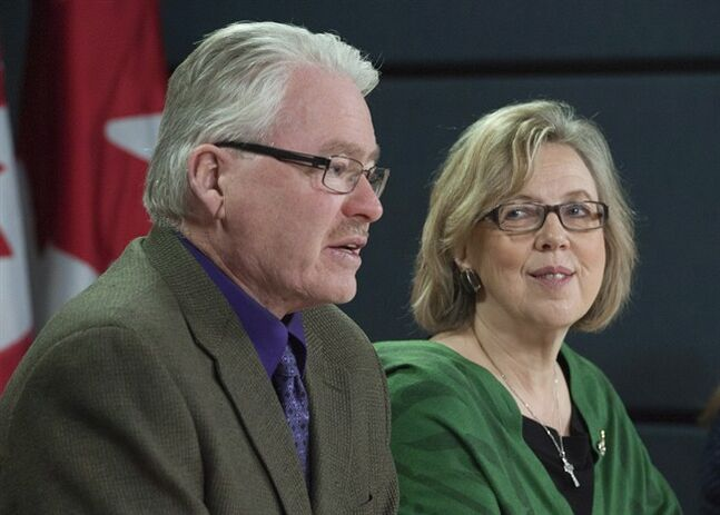 Green Party MP Bruce Hyer speaks at a press conference after being announced as the party's deputy leader by leader Elizabeth May, right, in Ottawa on Monday, Jan. 27, 2014. THE CANADIAN PRESS/Justin Tang