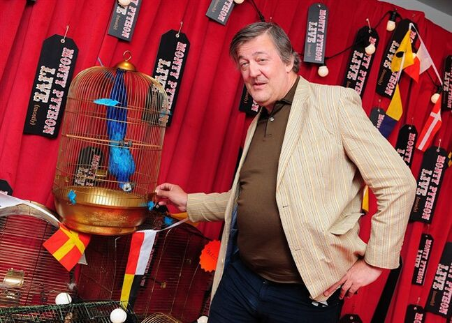 Stephen Fry arriving for the first night performance of the Monty Python Show Live at the O2 Arena, London, Tuesday July 1, 2014. (AP Photo/PA, Ian West) UNITED KINGDOM OUT NO SALES NO ARCHIVE
