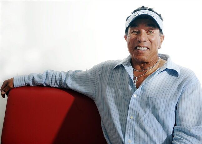 "In this July 12, 2014 photo, Motown legend Smokey Robinson poses for a photo, in Los Angeles. Robinson's his latest album, ""Smokey & Friends,"" comes out Tuesday, Aug. 19, 2014. The collection of Robinson tunes pairs the Motown veteran with Elton John, Mary J. Blige, James Taylor, CeeLo Green, Miguel, and Steven Tyler. (Photo by Katy Winn/Invision/AP)"