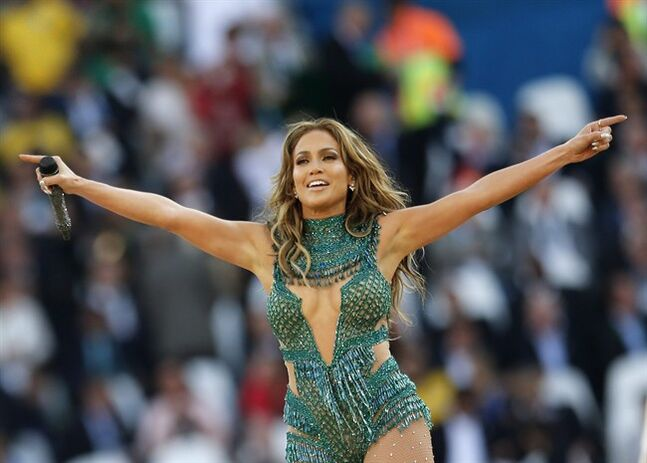FILE - In this June 12, 2014 file photo, pop singer singer Jennifer Lopez performs at the 2014 World Cup opening ceremony in the Itaquerao Stadium in Sao Paulo, Brazil. A group of of scientists named a water mite in Lopez's honor after discovering a new species near Puerto Rico. The music of the Bronx, New York-born entertainer who has Puerto Rican roots was a hit with the group while they wrote about their findings, biologist Vladimir Pesic said in an email Wednesday, July 16, 2014. (AP Photo/Frank Augstein)