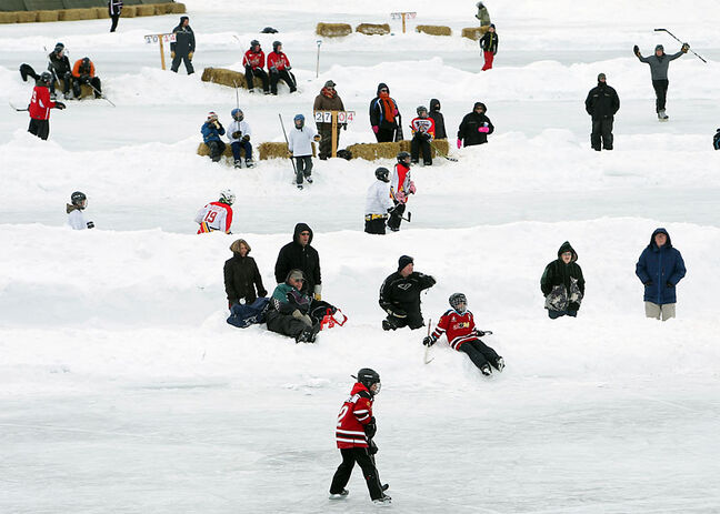 Children play hockey during Skate the Lake in Minnedosa earlier this month. Continuing chilly temperatures will make it plenty safe on the ice in most places.