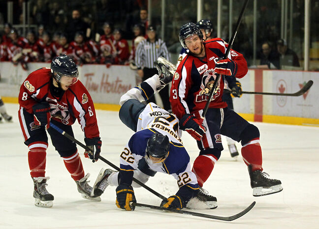 Souris native Tanner Butler, left, and Dauphin Kings teammate Brett Sharples upend Lucas Skrumeda of the Winnipeg Blues during the Manitoba Junior Hockey League final. Both teams will compete in the Western Canada Cup, beginning Saturday in Dauphin.