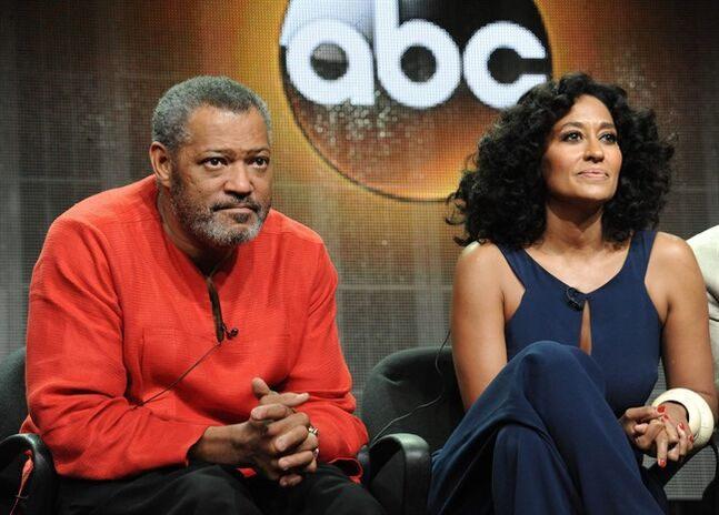 Laurence Fishburne, left, and Tracee Ellis Ross speak onstage at the 'Black-ish'' panel at the Disney/ABC Television Group 2014 Summer TCA at the Beverly Hilton Hotel on Tuesday, July 15, 2014, in Beverly Hills, Calif. (Photo by Richard Shotwell/Invision/AP)