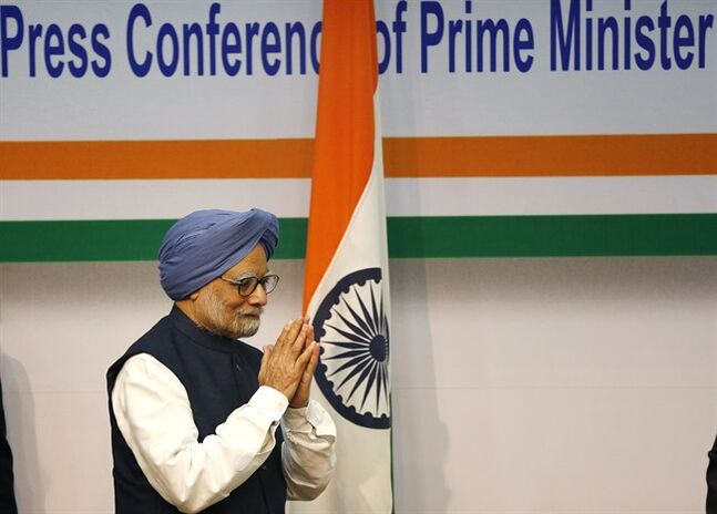 Indian Prime Minster Manmohan Singh greets during a press conference, in New Delhi, India, Friday, Jan. 3, 2014. Prime Minister Singh said Friday he would step aside after 10 years in office, paving the way for Rahul Gandhi to take the reins of the world's biggest democracy if his party stays in power in this year's elections. (AP Photo/Harish Tyagi, Pool)