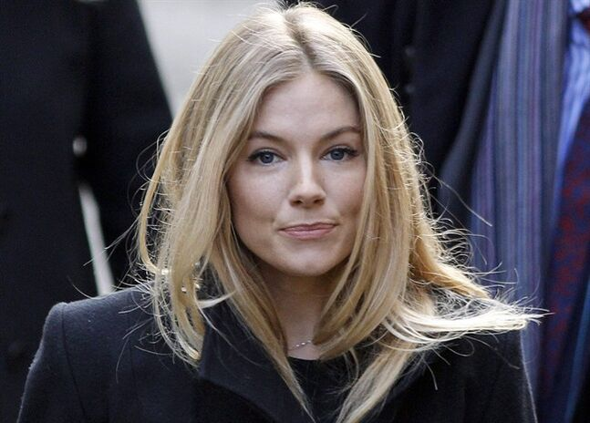 FILE- This Thursday, Nov. 24, 2011 file photo shows British actress Sienna Miller in London. Miller told Britain's phone-hacking trial on Friday Jan. 31 2014 she had a