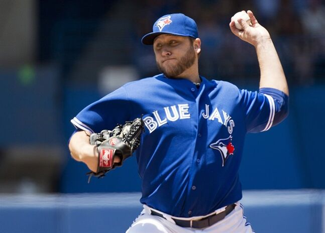 Toronto Blue Jays starting pitcher Mark Buehrle works against the Kansas City Royals during first inning AL baseball action in Toronto on Sunday, June 1, 2014. THE CANADIAN PRESS/Nathan Denette