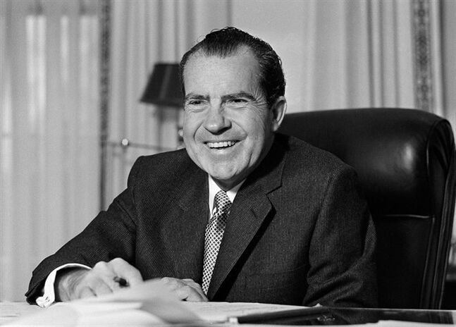 CORRECTS DATE OF NIXON'S RESIGNATION TO AUG. 9, INSTEAD OF AUG. 7. - FILE - This Jan. 21, 1969 file photo shows President Richard Nixon at his desk at the White House in Washington. Nixon suffered a stroke in 1994 and died days later at age 81. Saturday, Aug. 9, 2014, marks the 40th anniversary of his resignation. (AP Photo/File)