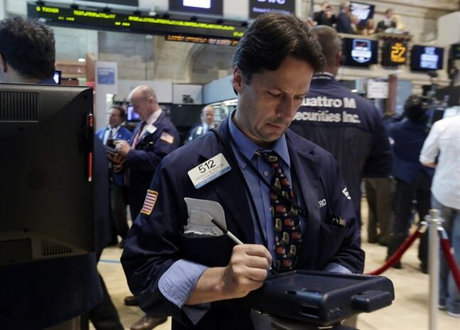 Trader Patrick McKeon works on the floor of the New York Stock Exchange Tuesday, May 27, 2014. Stocks rose Tuesday after the government reported that orders for big-ticket items rose unexpectedly last month. (AP Photo/Richard Drew)