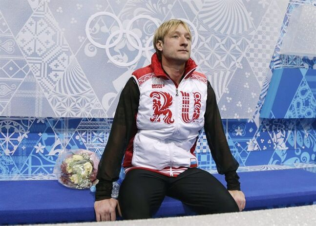 Evgeni Plushenko of Russia sits after competing in the men's team free skate figure skating competition at the Iceberg Skating Palace during the 2014 Winter Olympics, Sunday, Feb. 9, 2014, in Sochi, Russia. (AP Photo/Darron Cummings, Pool)