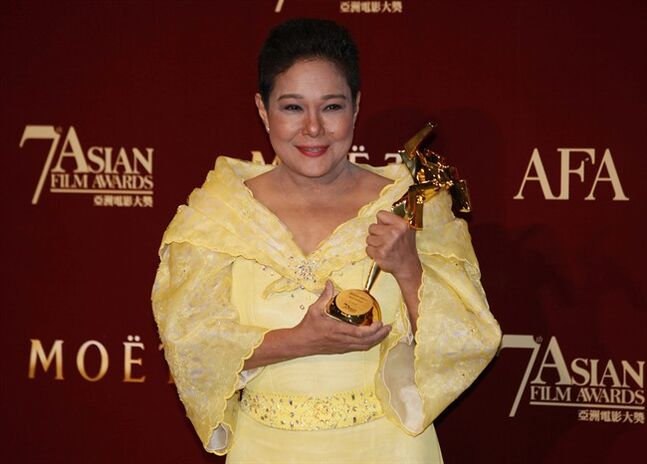 FILE - In this March 18, 2013 file photo, Philippine actress Nora Aunor poses with her trophy after winning the Best Actress Award of her movie