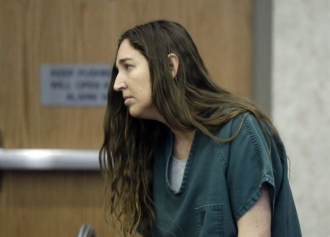 Megan Huntsman, accused of killing six of her babies and storing their bodies in her garage, appears in court Monday, April 28, 2014, in Provo, Utah. Prosecutors have filed six first-degree murder charges against Huntsman. (AP Photo/Rick Bowmer, Pool)