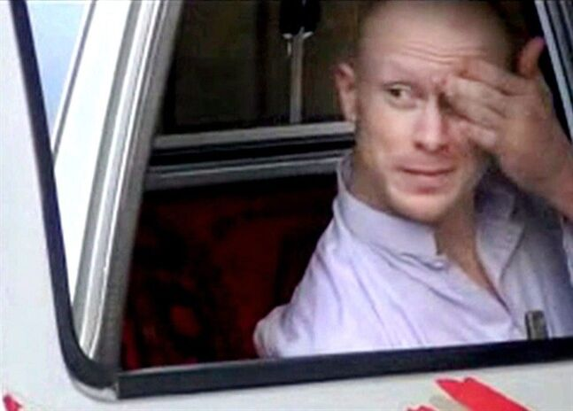 FILE - In this file image taken from video obtained from Voice Of Jihad Website, which has been authenticated based on its contents and other AP reporting, Sgt. Bowe Bergdahl, sits in a vehicle guarded by the Taliban in eastern Afghanistan. A senior defense official says Bowe Bergdahl, the Army sergeant who spent nearly five years as a Taliban captive in Afghanistan, has been returned to regular Army duty. As of Monday he is assigned to U.S. Army North at Joint Base San Antonio-Fort Sam Houston in Texas. That is the same location where he has been decompressing from the effects of his lengthy captivity. (AP Photo/Voice Of Jihad Website via AP video, File)