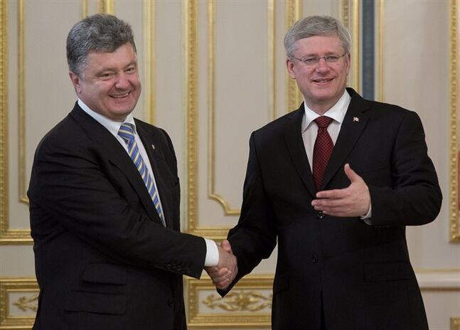 Ukranian President Petro Poroshenko meets with Canadian Prime Minister Stephen Harper several hours after Poroshenko was sworn in Saturday June 7, 2014 in Kyiv, Ukraine. THE CANADIAN PRESS/Adrian Wyld