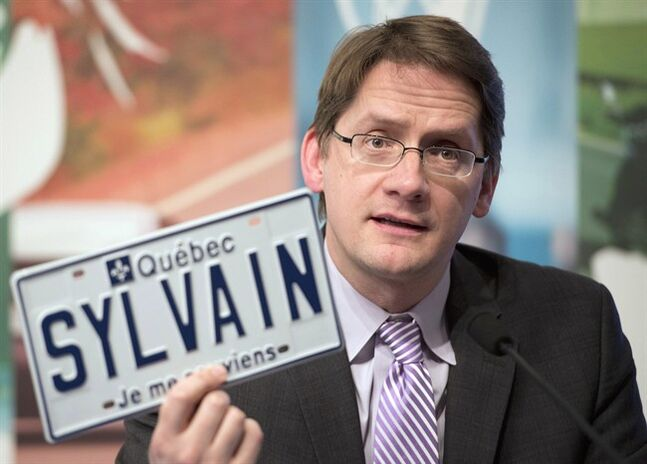 Quebec Transport Minister Sylvain Gaudreault announces the introduction od vanity plates, Thursday, January 30, 2014 in Quebec City. THE CANADIAN PRESS/Jacques Boissinot