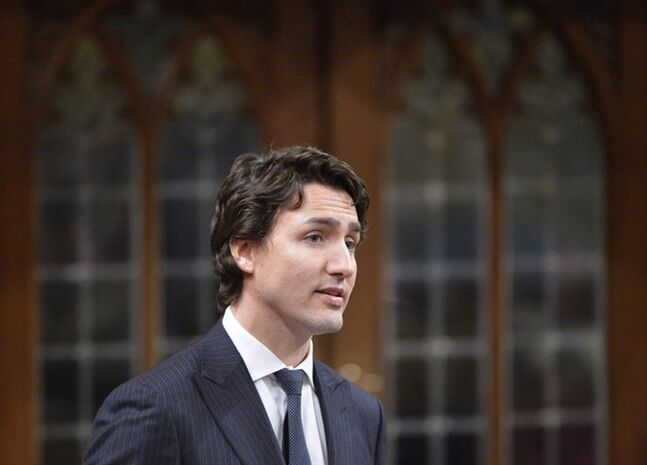 Liberal Leader Justin Trudeau asks a question during question period in the House of Commons on Parliament Hill in Ottawa on May 7, 2014. Who's the hardest working federal opposition leader, Tom Mulcair or Justin Trudeau? The two are engaged in a pre-election skirmish over that question, offering a glimpse of the pitched battle to come between New Democrats and Liberals next year, when each leader will attempt to persuade voters that he is more deserving than the other to replace Prime Minister Stephen Harper. THE CANADIAN PRESS/Adrian Wyld