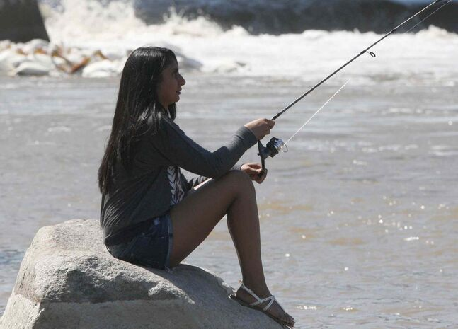 Bilaxshy Sibaturunathan relaxes while fishing on the Red River at Lockport, Man., last week.